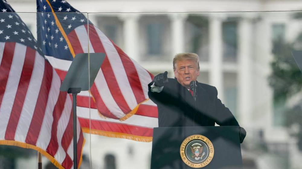 Trump-behind-glass